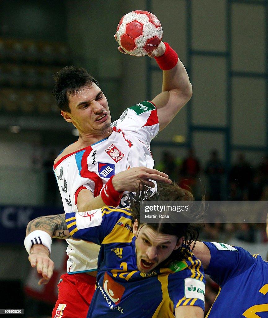 Krysztof Lijewski of Poland tackles Frederik Petersen of Sweden during the Men's Handball European Championship Group C match between Poland and...