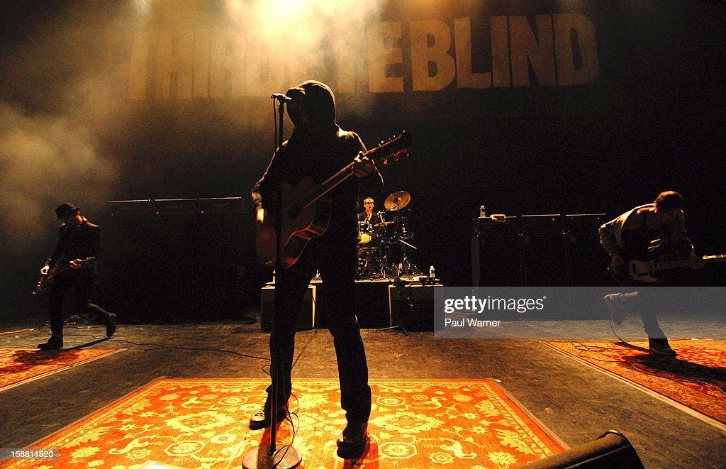 Kryz Reid, Stephan Jenkins, Brad Hargreaves and Jon Pancoast of Third Eye Blind perform at The Fillmore on December 29, 2012 in Detroit, Michigan.