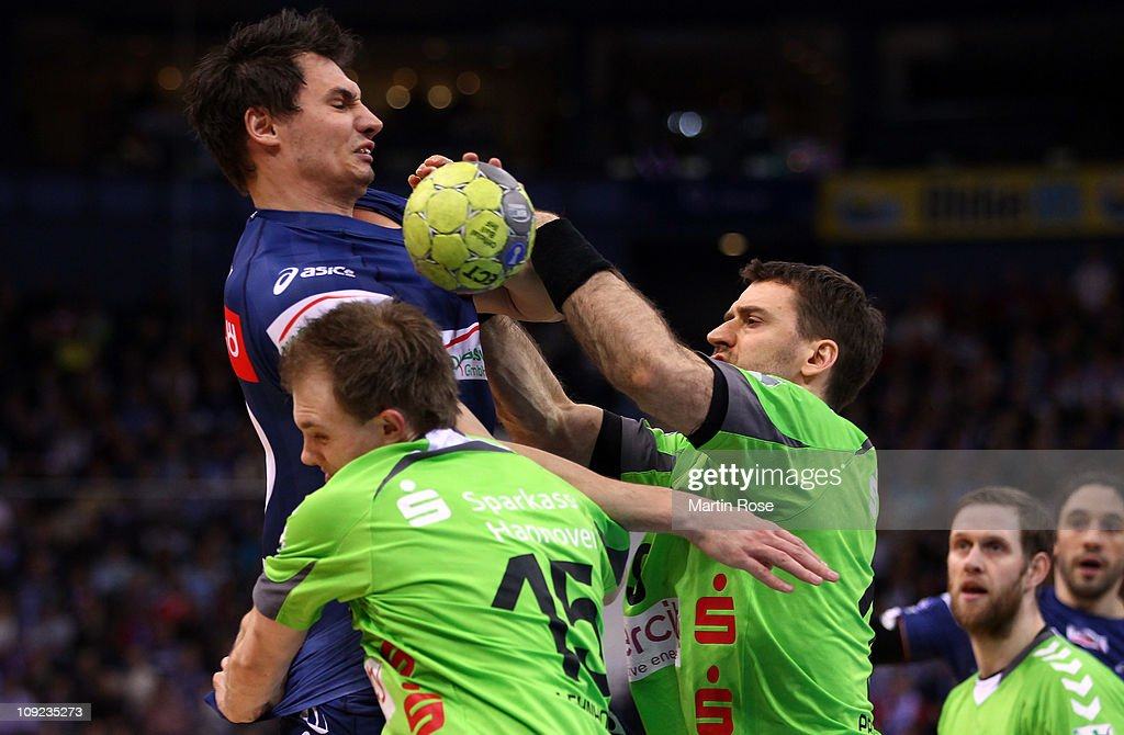 Kryzstof Lijewski (L) of Hamburg is challenged by Piotr Przybek (R) of Hannover-Burgdorf during the Toyota Handball Bundesliga match between HSV Hamburg and Hannover-Burgdorf at the o2 World Arena on Fevruary 17, 2011 in Hamburg, Germany.
