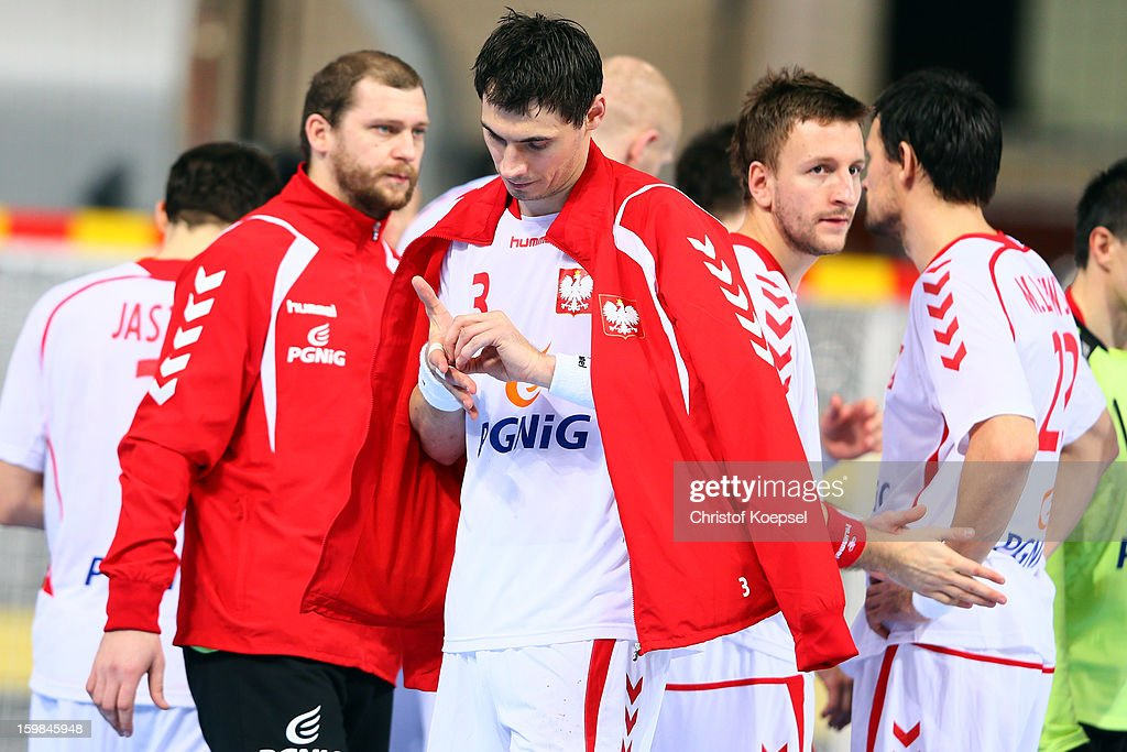 Krzystof Lijewski of Poland looks dejected after the round of sixteen match between Hungary and Poland at Palau Sant Jordi on January 21 2013 in...