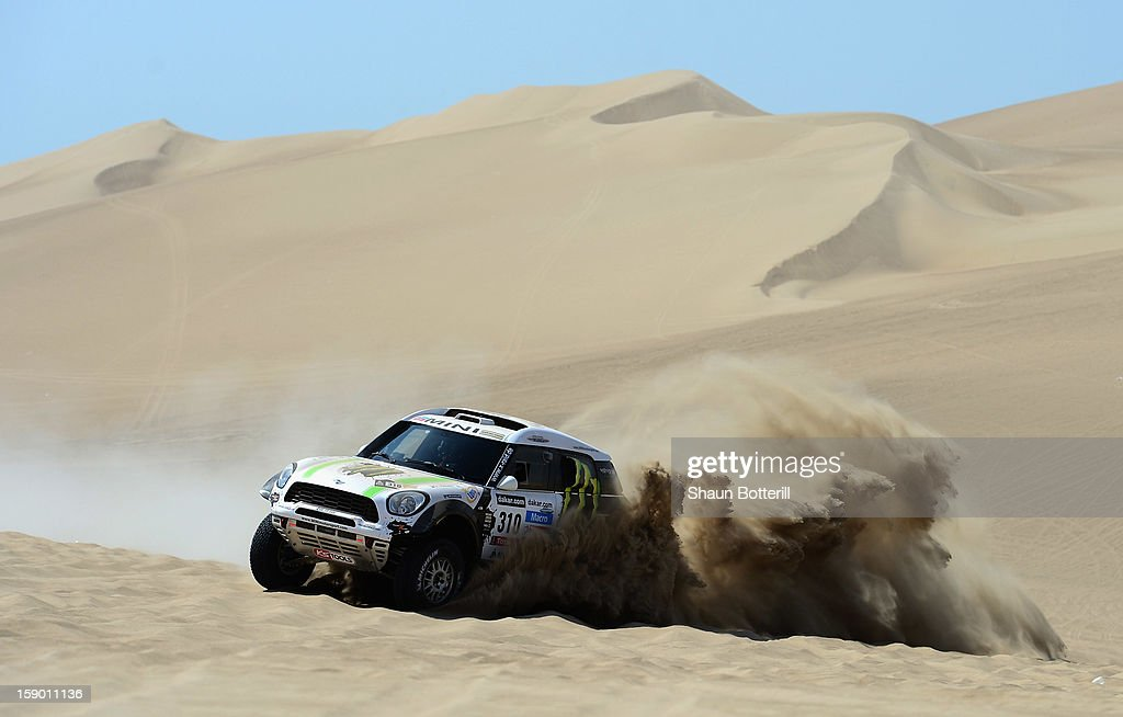 Krzysztof Holowczyc and co-pilot Filipe Palmeiro of team Mini compete during the special stage of day one of the of the 2013 Dakar Rally on January 5, 2013 in Pisco, Peru.