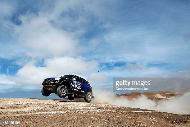 Krzysztof Holowczyc of Poland and Xavier Panseri of France driving for the ALL4 Racing Mini Monster Energy Rally Raid Team compete in the Atacama...