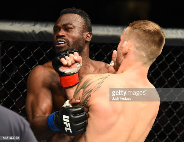 Krzysztof Jotko of Poland punches Uriah Hall of Jamaica in their middleweight bout during the UFC Fight Night event inside the PPG Paints Arena on...