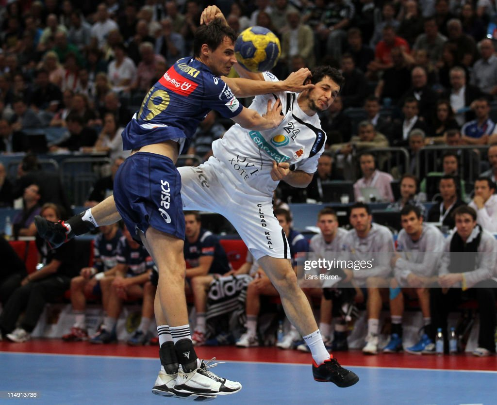 Krzysztof Lijewski challenges Alberto Entrerrios of Ciudad during the EHF Final Four semi final match between Ciudad Real and HSV Hamburg at Lanxess...