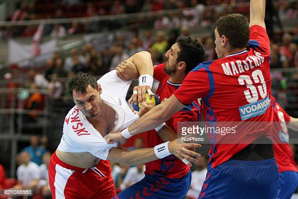 Krzysztof Lijewski Ilija Abutovic Mijajlo Marsenic in action during the 2018 Men's European Championship Qualification match between Poland v Serbia...