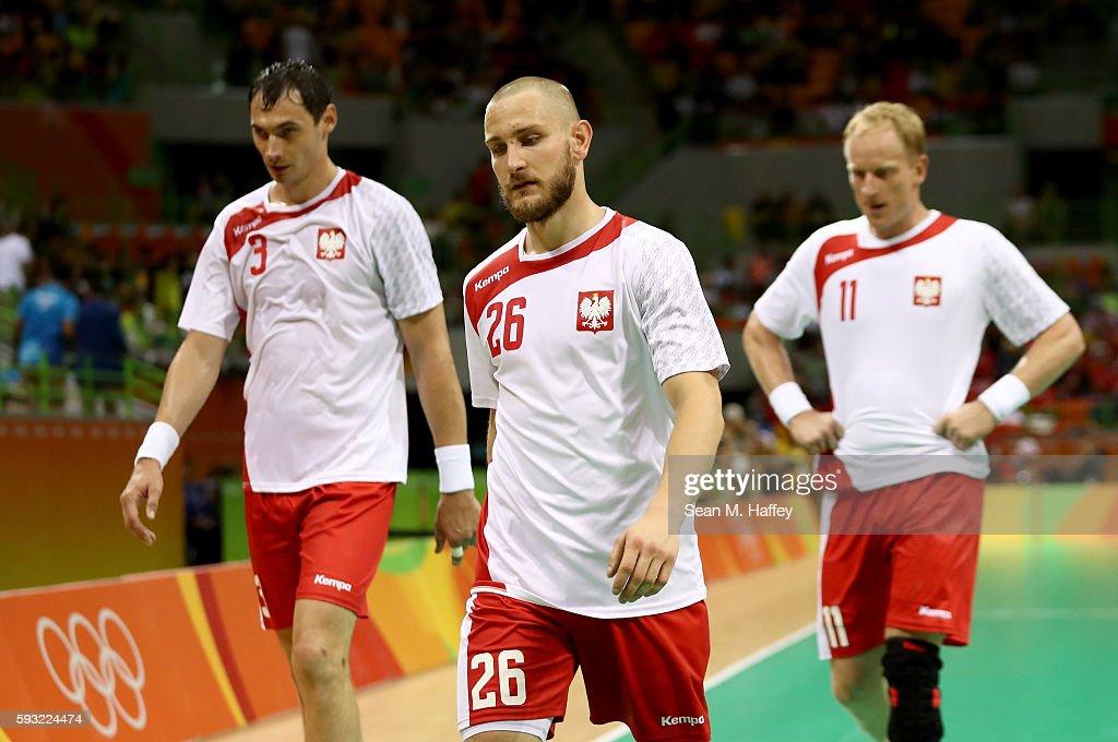 Krzysztof Lijewski Michal Daszek and Adam Wisniewski of Poland look dejected during the Men's Bronze Medal Match between Poland and Germany on Day 16...