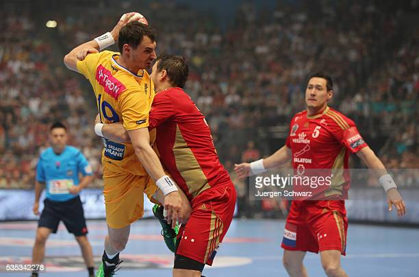 Krzysztof Lijewski of Kielce is blocked during the EHF Champions League Final between KS Vive Tauron Kielce and MKB Veszprem on May 29 2016 in...