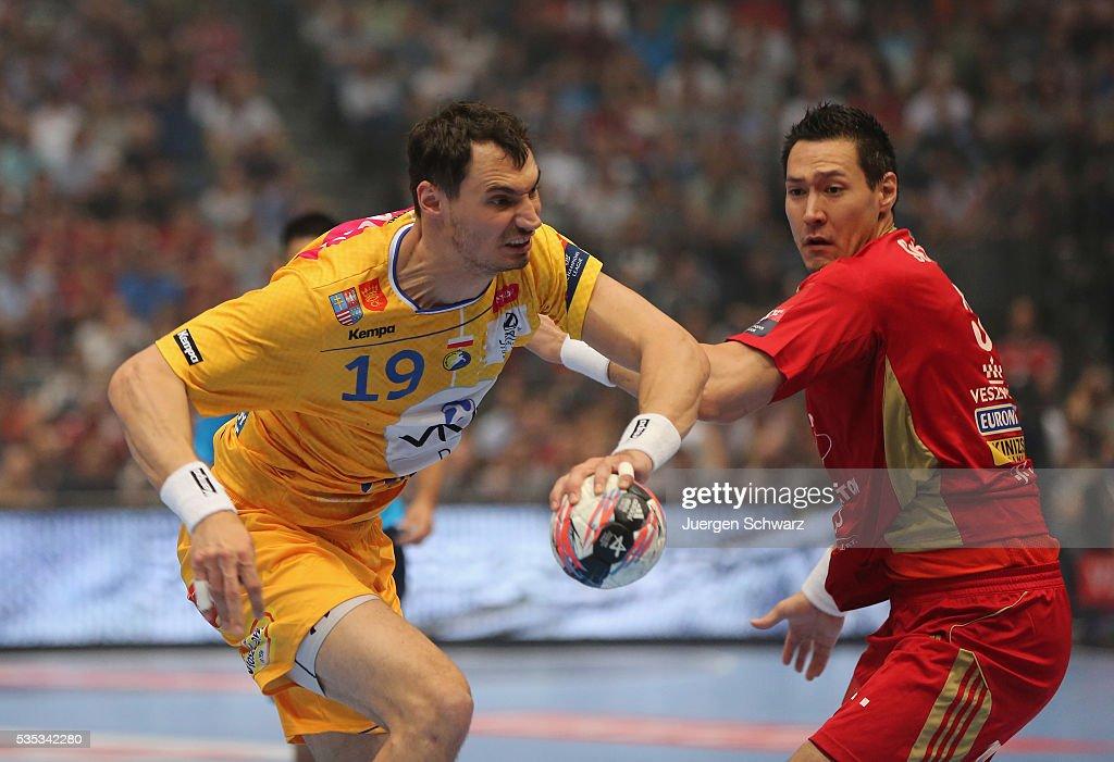 Krzysztof Lijewski of Kielce tackles Istvan Timuzsin Schuch of Veszprem during the EHF Champions League Final between KS Vive Tauron Kielce and MKB...