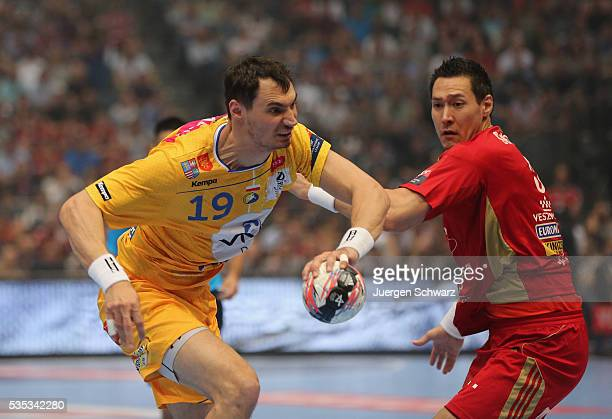 Krzysztof Lijewski of Kielce tackles Istvan Timuzsin Schuch of Veszprem during the EHF Champions League Final between KS Vive Tauron Kielce and MKB...