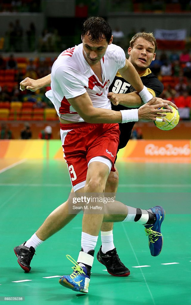 Krzysztof Lijewski of Poland is challenged by Paul Drux of Germany during the Men's Bronze Medal Match between Poland and Germany on Day 16 of the...