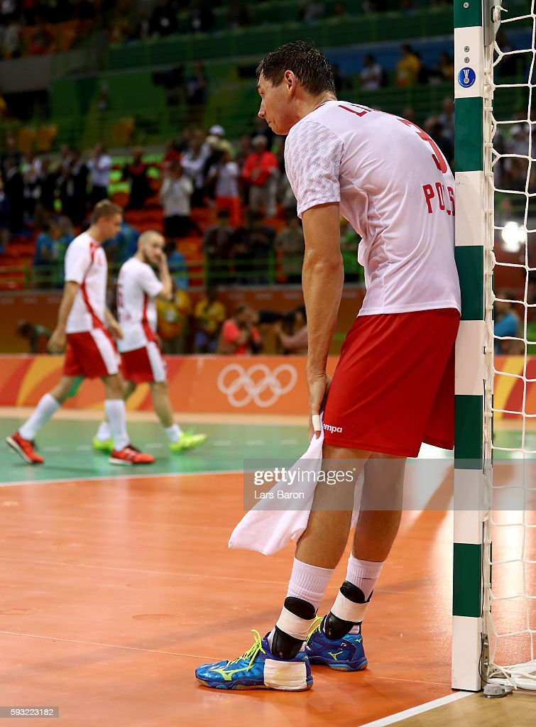 Krzysztof Lijewski of Poland looks dejected after their defeat in the Men's Bronze Medal Match between Poland and Germany on Day 16 of the Rio 2016...
