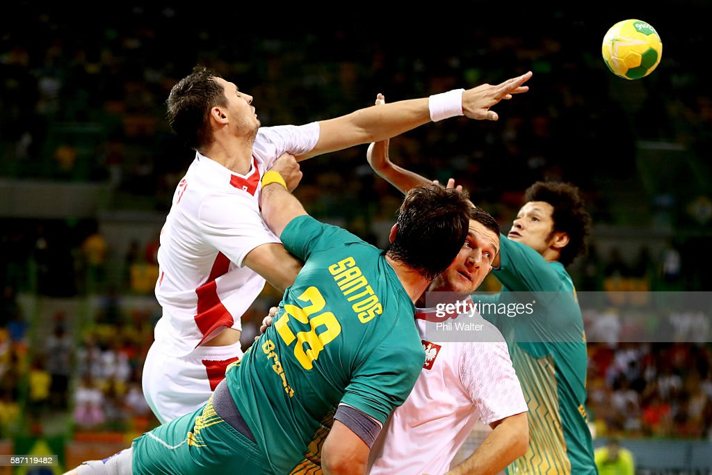 Krzysztof Lijewski of Poland passes during the Mens Preliminary Group B match between Poland and Brazil at the Future Arena on Day 2 of the Rio 2016...