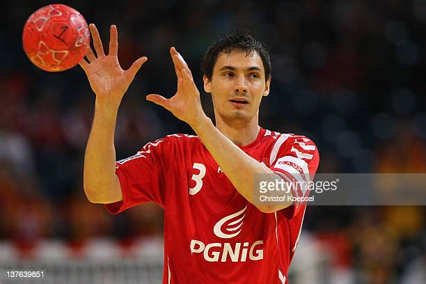 Krzysztof Lijewski of Poland passes the ball during the Men's European Handball Championship second round group one match between Poland and...