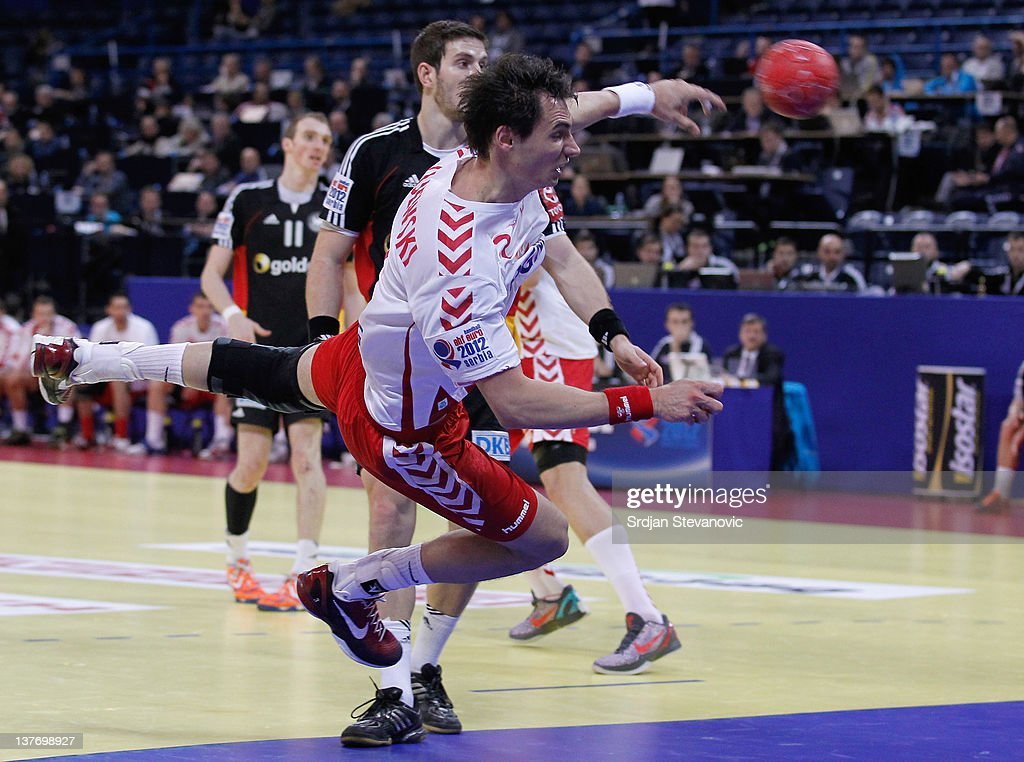 Krzysztof Lijewski (C) of Poland shoots at goal during the Men's European Handball Championship 2012 second round group one match between Poland and Germany at Arena Hall on January 25, 2012 in Belgrade, Serbia.