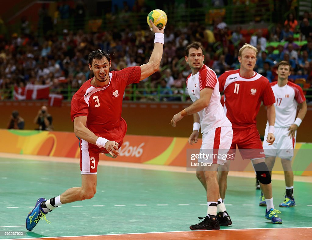 Krzysztof Lijewski of Poland takes a shot during the Men's Handball Semifinal match between Poland and Denmark on Day 14 of the Rio 2016 Olympic...