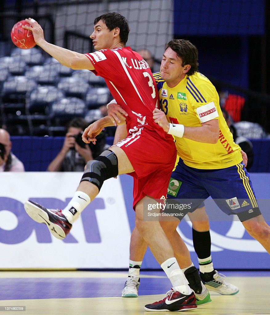 Krzysztof Lijewski (L) of Poland vies with the Jonathan Stenbacken (R) of Sweden during the Men's European Handball Championship 2012 main group 1, match between Poland and Sweden at Belgrade Arena Hall on January 21, 2011 in Belgrade, Serbia.