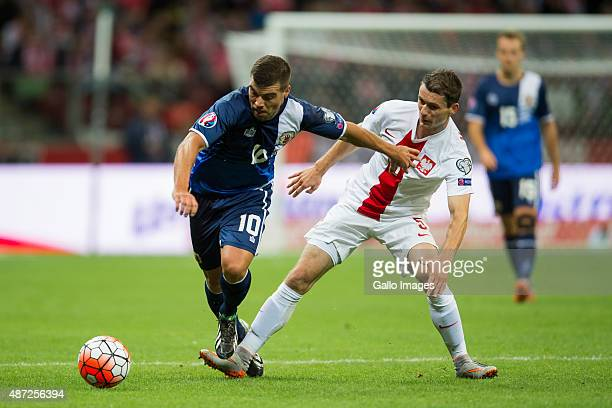 Krzysztof Maczynski and Liam Walker during the UEFA Euro 2016 Qualifying Round match between Poland and Gibraltar at the National Stadium on...