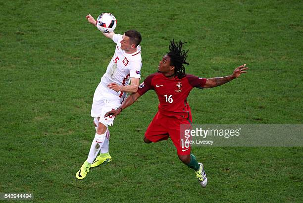 Krzysztof Maczynski of Poland and Renato Sanches of Portugal compete for the ball during the UEFA EURO 2016 quarter final match between Poland and...