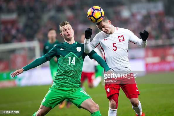 Krzysztof Maczynski of Poland vies Aleks Pihler of Slovenia during the international friendly football match Poland vs Slovenia on November 14 2016...