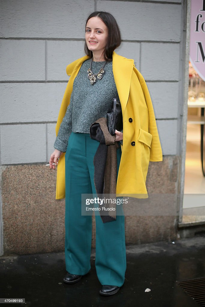 Ksene Kurkina wears Marella coat and Prada shoes on day 1 of Milan Fashion Week Womenswear Autumn/Winter 2014 on February 19, 2014 in Milan, Italy.