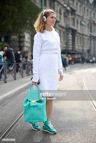 Ksenia Lapshova wears Nnedre top and skirt Imakebags backpack and Afour shoes on September 20 2014 in Milan Italy