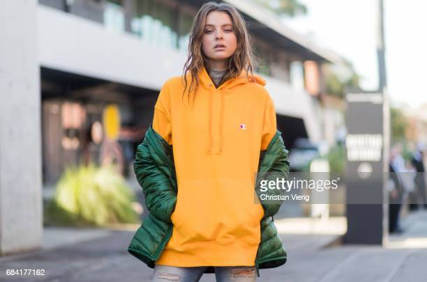 Ksenija Lukich wearing yellow Vetements hoody ripped denim jeans at day 4 during MercedesBenz Fashion Week Resort 18 Collections at Carriageworks on...