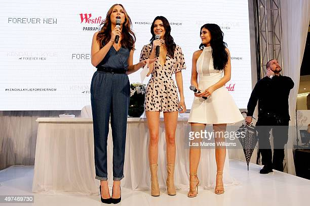 Ksenija Lukich welcomes Kendall and Kylie Jenner to the stage at Westfield Parramatta on November 17 2015 in Sydney Australia