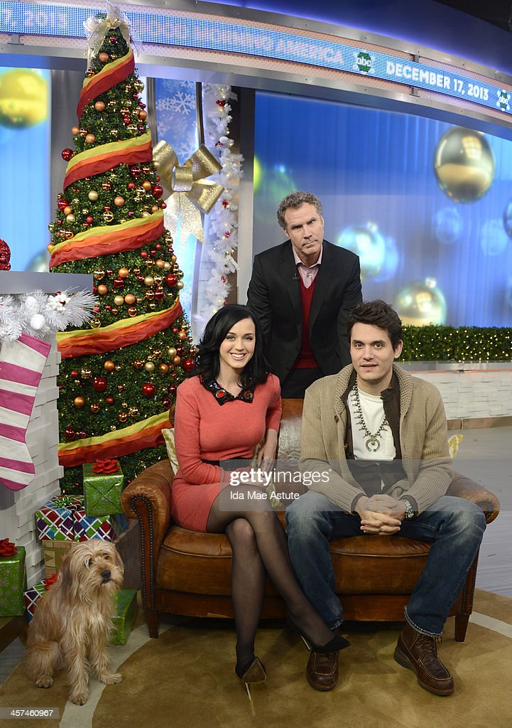 AMERICA - Ksty Perry and John Mayer visited Times Square to debut the world exclusive premiere of the music video Who You Love on GOOD MORNING AMERICA, 12/17/13, airing on the ABC Television Network. They are joined by Will Ferrell and Baxter the dog. (Photo by Ida Mae Astute/ABC via Getty Images) KATY
