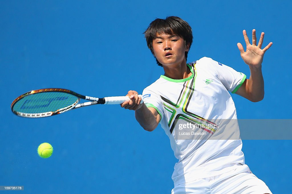 Ku Keon Kang of Korea plays a forehand in his first round match against Elias Ymer of Sweden during the 2013 Australian Open Junior Championships at Melbourne Park on January 20, 2013 in Melbourne, Australia.