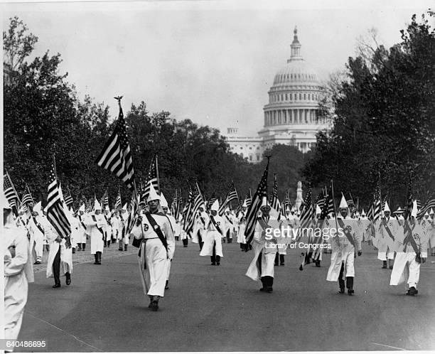 Image result for ku klux klan 1920s marching thru Washington DC getty images
