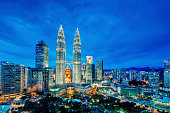 A cityscape with Petronas towers of the downtown area of Kuala Lumpur, capital city of Malaysia