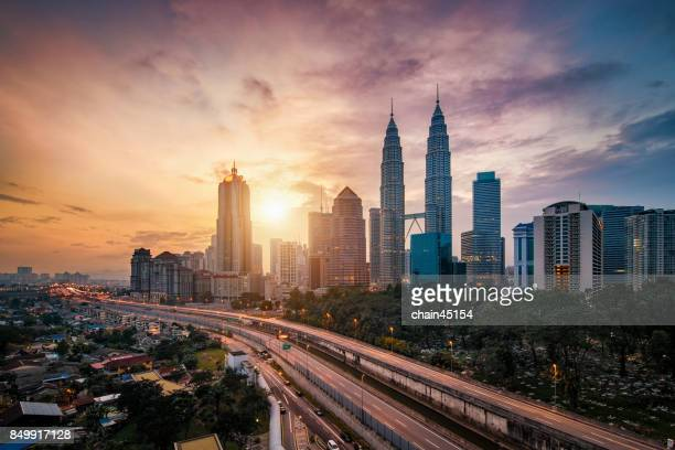 Kuala Lumpur City Centre during sunrise from rooftop of building