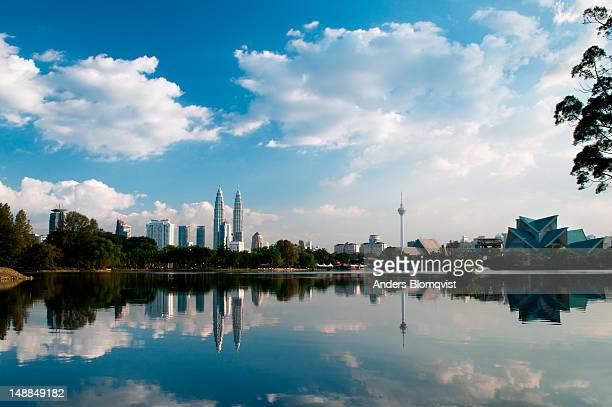 Kuala Lumpur city skyline reflected in Lake Titiwangsa.