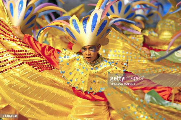A dancer performs a birddance during the Citrawarna festival parade in downtown Kuala Lumpur late 08 July 2006 Participants decked in costumes...