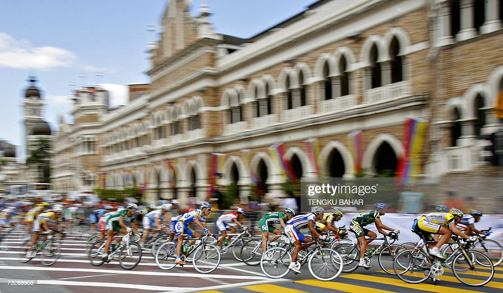 Cyclists ride past the historic Sultan Abdul Samad building during the tenth and final stage of the Tour de Langkawi bicycle race in Kuala Lumpur 11...