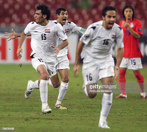 Iraqi football players celebrate after defeating South Korean in a penalty shootout during the semifinal of the Asian Football Cup 2007 at the Bukit...
