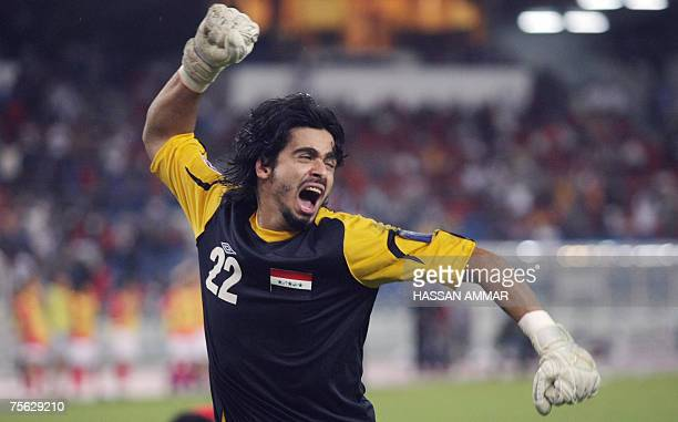 Iraqi goalkeeper Noor Sabri Abbas celebrates after saving a ball during a penalty shootout at the Asian Football Cup 2007 semifinal match between...