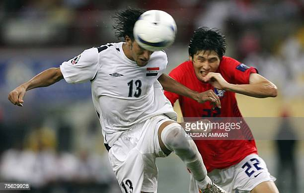 Iraqi midfielder Karrar Jassim Mohammed fights for the ball against South Korea player Kang Minsoo during their Asian Football Cup 2007 semifinal...