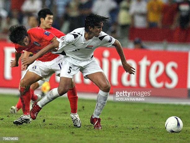 Iraqi midfielder Nashat Akram and South Korea's Yeom Kihun vie for the ball during the semifinals of the Asian Football Cup 2007 at the Bukit Jalil...