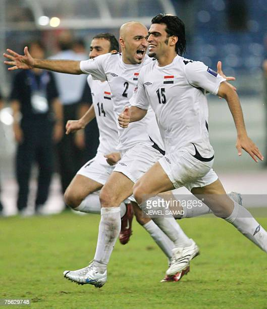 Iraqi national football team players celebrate after defeating South Korea in their Asian Football Cup 2007 semifinal match at the Bukit Jalil...