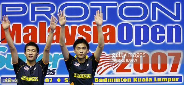 Malaysia's Koo Kien Keat and Tan Boon Heong celebrate at the winner's podium after defeating IndonesiaUS doubles team Candra Wijaya and Tony Gunawan...