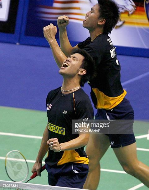 Malaysia's Koo Kien Keat and Tan Boon Heong react after reaching match point before defeating IndonesiaUS doubles team Candra Wijaya and Tony Gunawan...