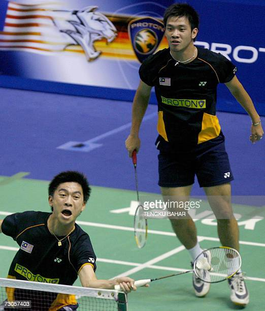 Malaysia's Tan Boon Heong recovers a drop shot while Koo Kien Keat looks on during their match against IndonesiaUS doubles team Candra Wijaya and...