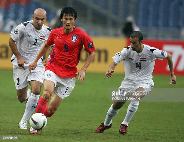 South Korean player Cho Jaejin runs through Iraqi players during the semifinal match between Iraq and South Korea of the Asian Football Cup 2007 at...