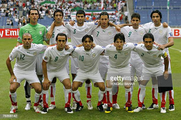 The Iranian national football team poses for a group photograph before the Asian Football Cup Group C match between Iran and Uzbekistan at the Bukit...
