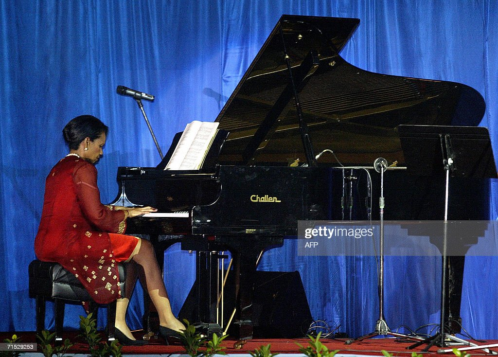US Secretary of State Condoleezza Rice plays the piano at a gala dinner for the 39th Association of Southeast Asian Nations (ASEAN) ministerial meeting in Kuala Lumpur 27 July 2006. Rice, a trained classical pianist, was likely to leave Malaysia 29 July after earlier indicating she would cut short her Asian trip to head back to the Middle East or Europe amid uncertainty in the current Middle East crisis.