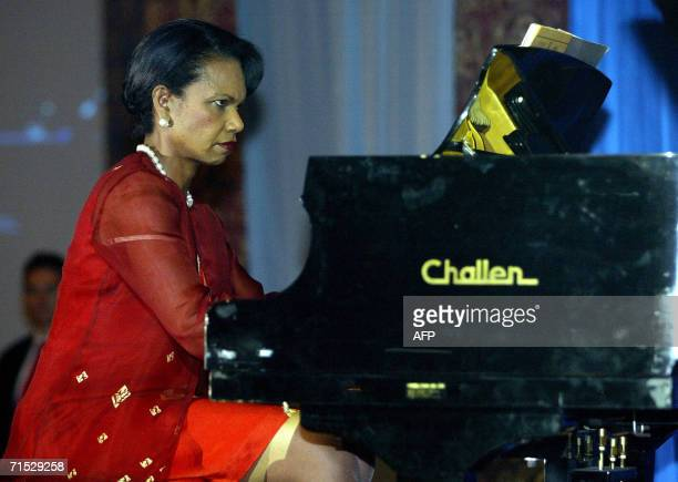US Secretary of State Condoleezza Rice plays the piano at a gala dinner for the 39th Association of Southeast Asian Nations ministerial meeting in...