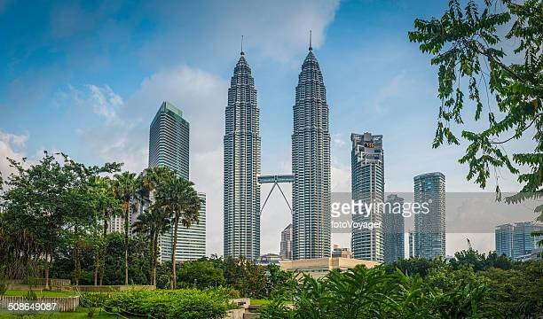Kuala Lumpur Petrona Towers skyscrapers framed by foliage KLCC Malaysia