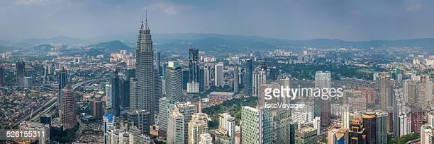 Kuala Lumpur Petronas Towers overlooking crowded skyscraper cityscape panorama Malaysia