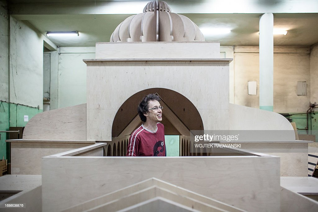 Kuba Kaminski - owner of Tryktrak carpentry workshop is seen in a 1:10 scale model of the largest synagogue in pre-war Warsaw, Great Synagogue in Warsaw, on May 12, 2013. The model will be installed on the place near the original location, on May 16, 2013 - 70 years after it was destroyed during World War II Warsaw Ghetto liquidation.